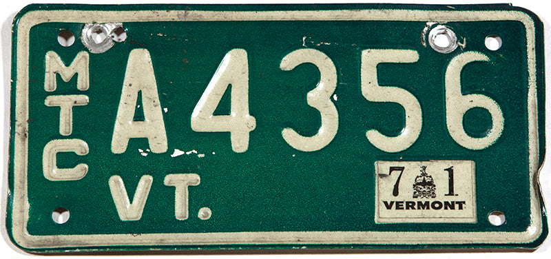 A 1971 Vermont motorcycle license plate in very good condition wtih 3 extra holes