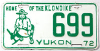 A 1972 Yukon passenger car license plate in very good plus condition with bends