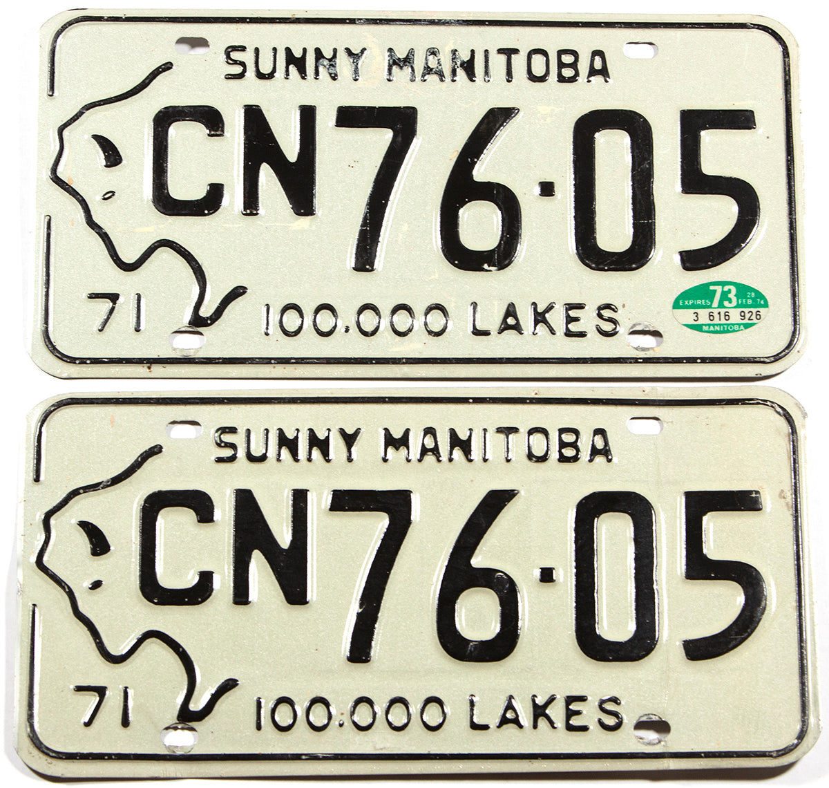 A classic pair of 1973 Manitoba passenger car license plates in very good plus condition
