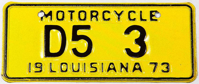 A classic NOS 1973 Louisiana motorcycle dealer license plate in NOS excellent plus condition