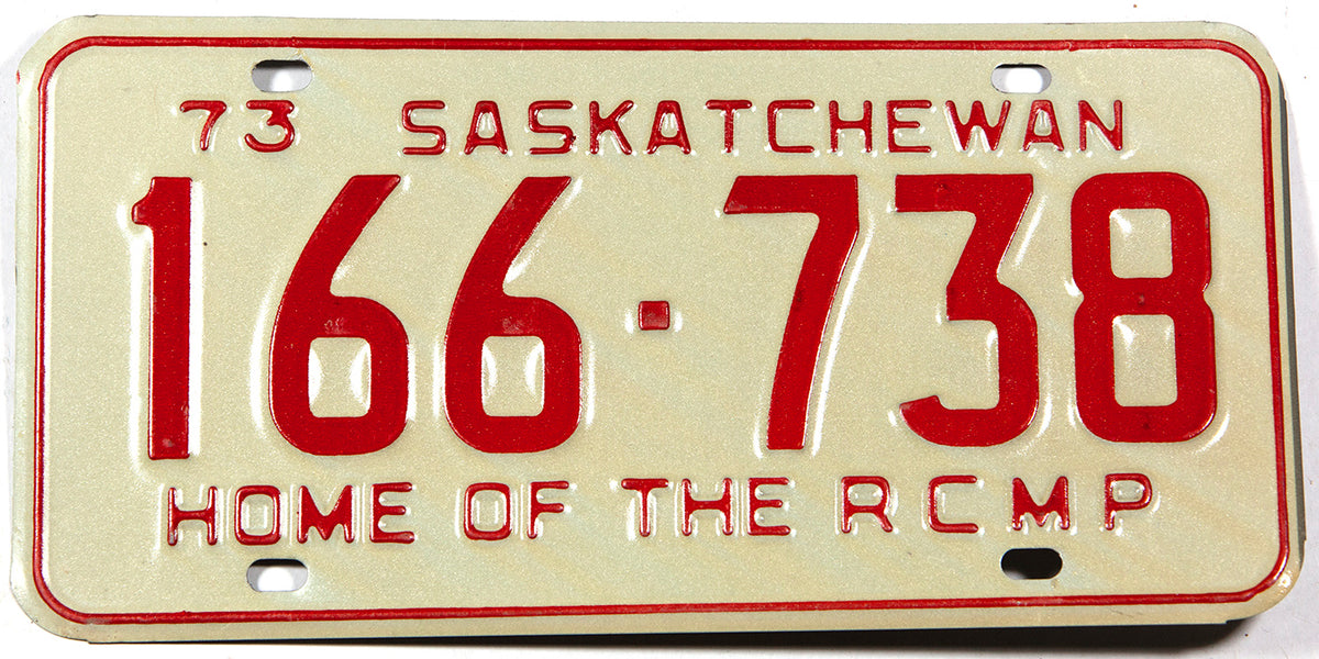 A classic 1973 NOS Saskatchewan passenger car license plate in New Old Stock excellent condition