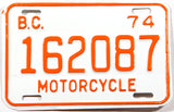 A classic 1974 British Columbia motorcycle license plate in New Old Stock Excellent Plus condition