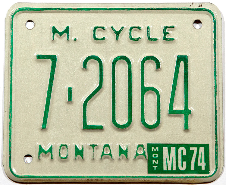 A classic 1974 Montana motorcycle license plate in New Old Stock excellent condition