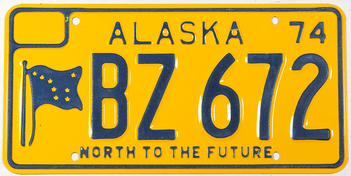 A classic 1974 Alaska passenger car license plate in unused excellent plus condition