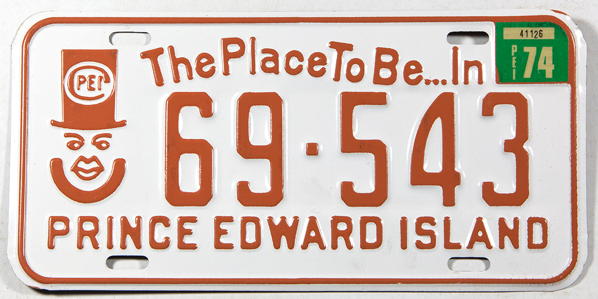 A classic 1974 NOS passenger car license plate from the Canadian province of Prince Edward Island in unused excellent plus condition