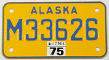 1975 Alaska motorcycle license plate in New Old Stock Near mint condition with wrapper