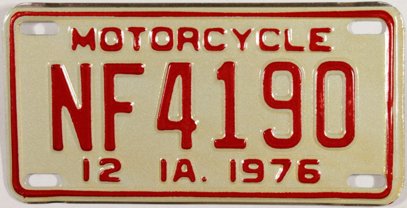 A classic NOS 1976 Iowa motorcycle license plate which will grade excellent plus