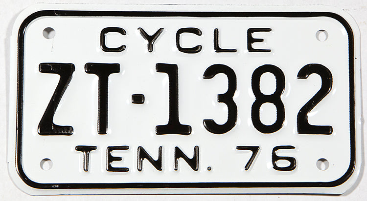 A classic NOS 1976 Tennessee Motorcycle License Plate in Near Mint condition