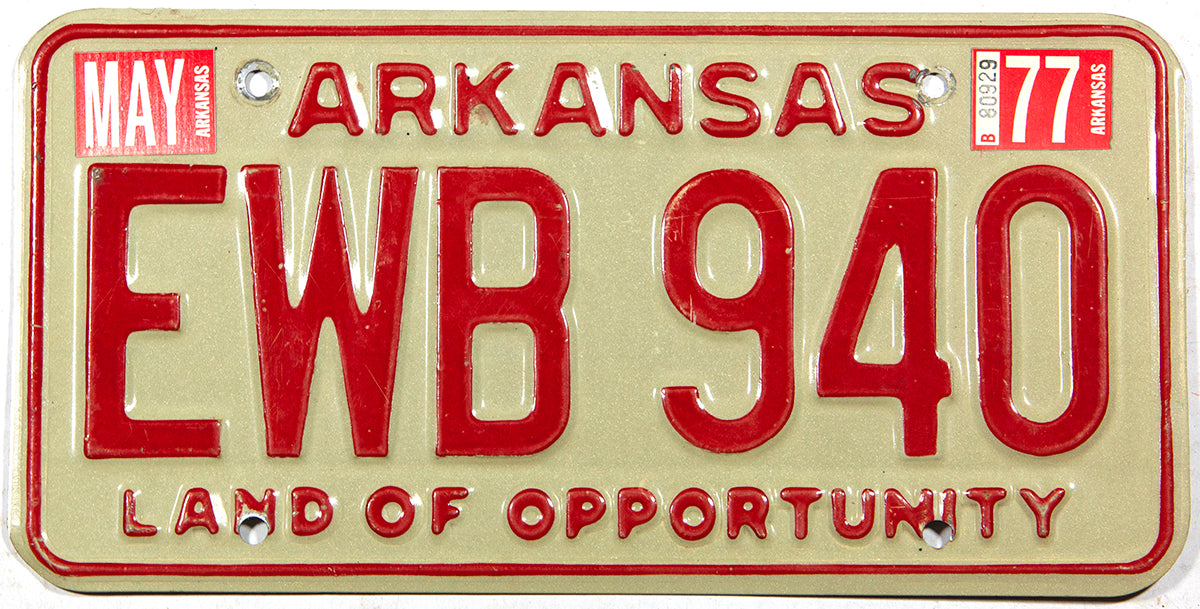 A classic 1977 Arkansas car license plate in excellent minus condition