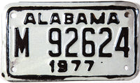 An unused NOS 1977 Alabama Motorcycle License Plate grading Excellent minus