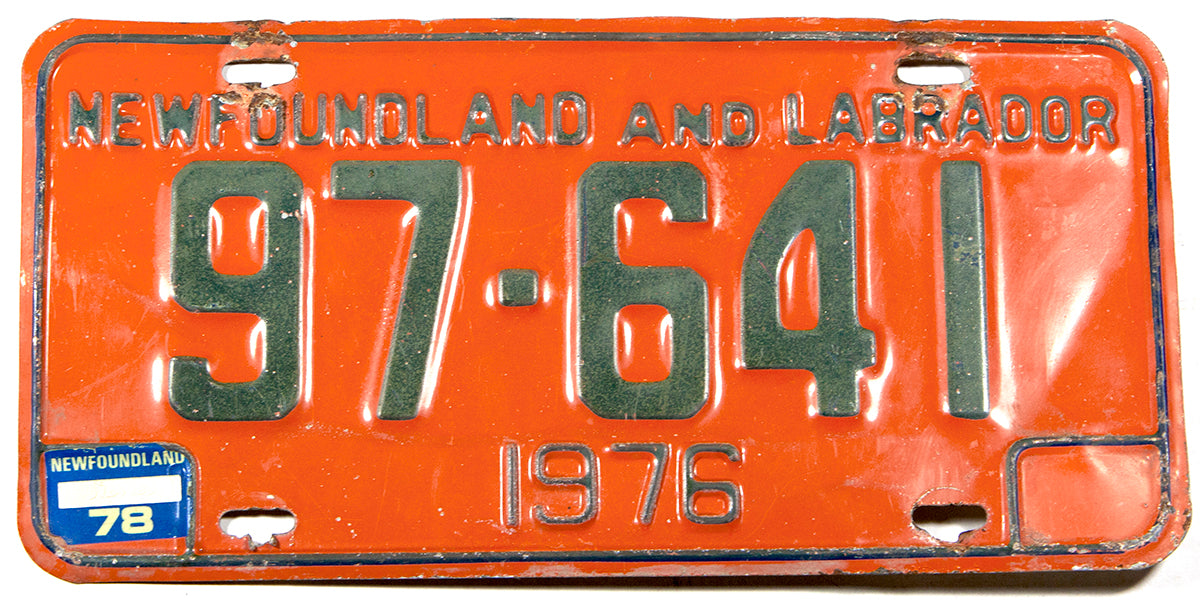 A 1978 Newfoundland and Labrador License Plate in very good condition with some damage at the bolt holes