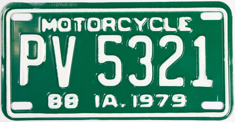 An antique NOS 1979 Iowa Motorcycle License Plate that is in excellent condition