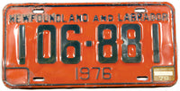 A 1979 Newfoundland and Labrador License Plate in very good condition with some bends in the metal