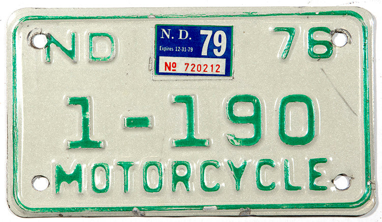A classic 1979 NOS North Dakota motorcycle license plate in very good plus condition