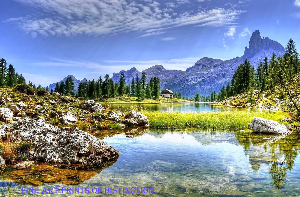Cabin at the Water's Edge in a Mountainous Landscape Premium Print