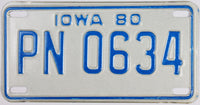 A 1980 Iowa Motorcycle License Plate that is in excellent plus condition