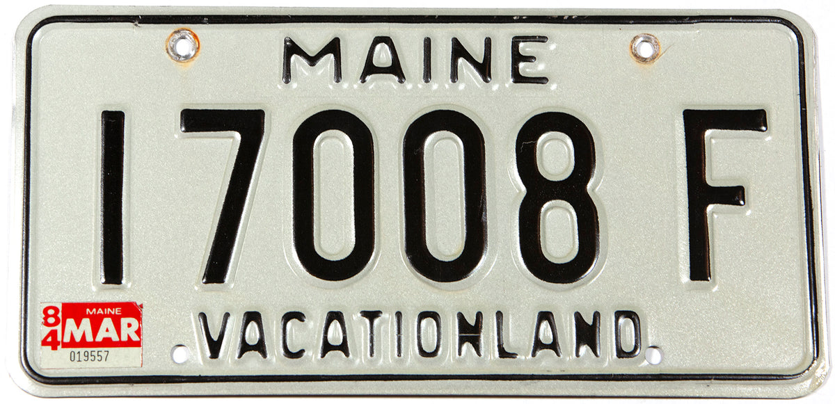 A classic 1984 Maine DMV car license plate in excellent minus condition