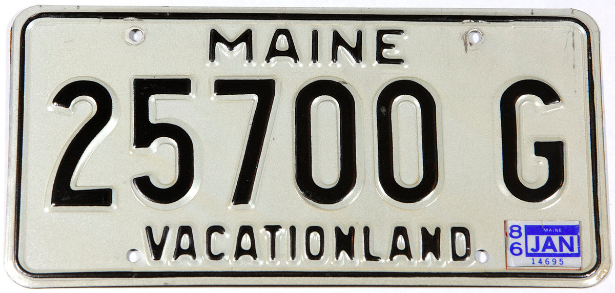 A classic 1986 Maine DMV car license plate in excellent minus condition