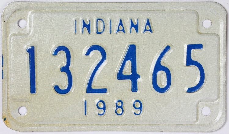 A NOS 1989 Indiana Motorcycle License Plate which is in Excellent Minus Condition