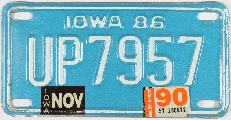 A 1990 Iowa Motorcycle License Plate which is in Excellent Minus Condition