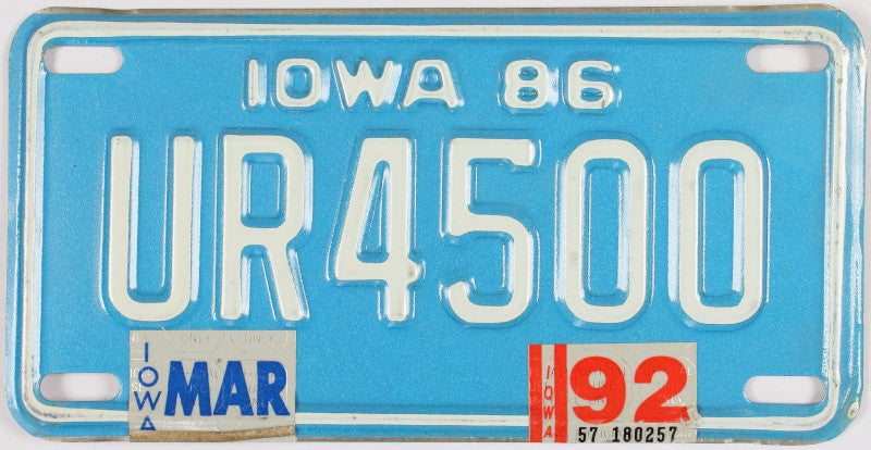 A 1992 Iowa Motorcycle License Plate - the color of this 92 IA Bike Tag is blue with white letters