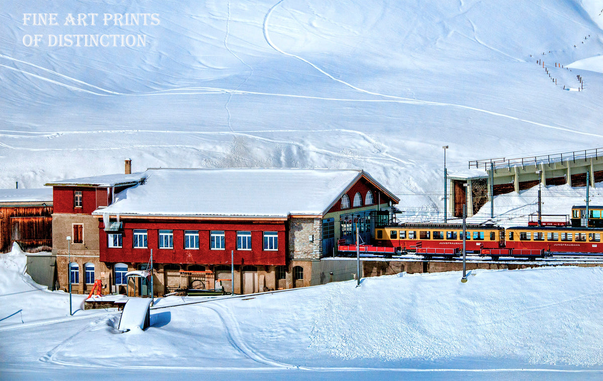 A Snowy Landscape with a Red Train Station premium print