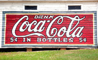 Coca Cola Advertisement painted on Old Store Building art print