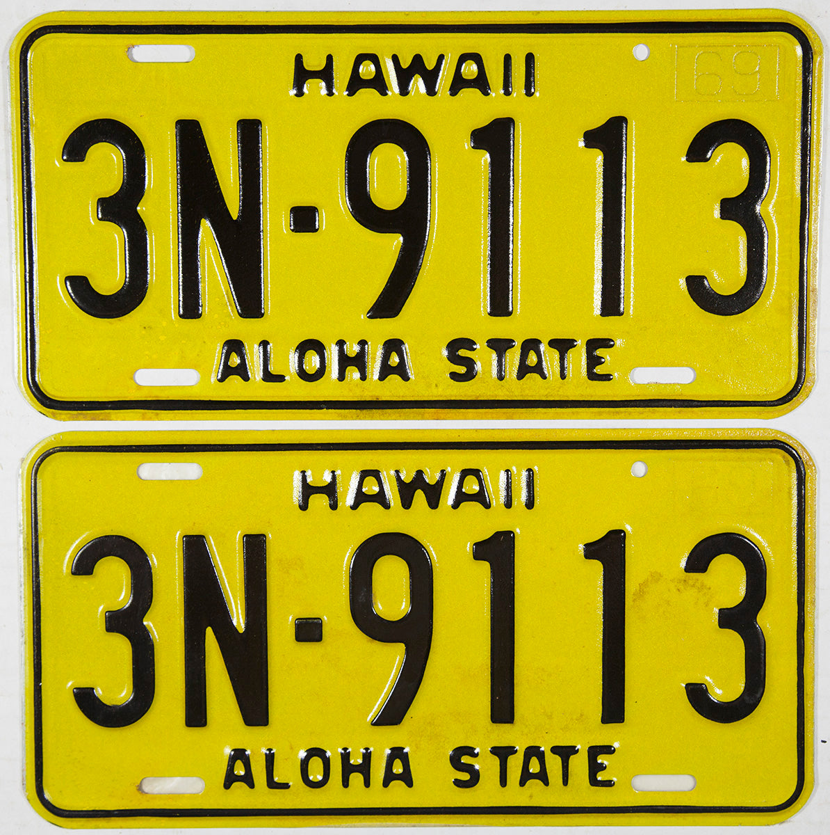 A pair of NOS 1969 Hawaii passenger car license plates