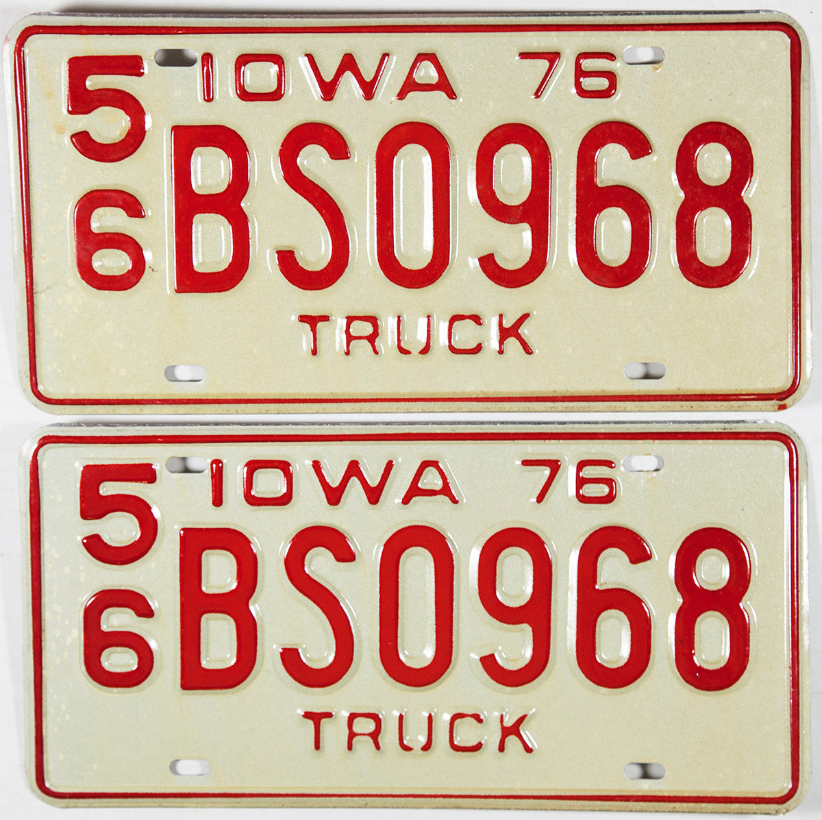 A pair of NOS 1976 Iowa Truck License Plates
