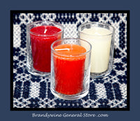 Set of three votive candle cups shown with candles in them