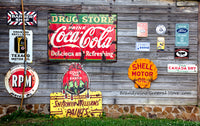 A premium art print of Shell Oil, Coke, Ivory Soap and more Ads nailed to a shed