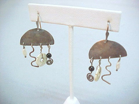 Kinetic hand hammered earrings signed AH, sterling