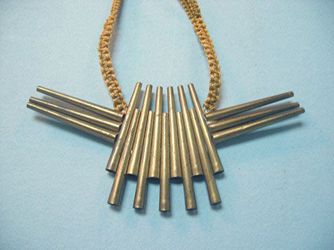 Winged brass tubing necklace ca. 1970s