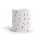 Sturdy white, 11 oz. glossy ceramic mug. Pours and holds the perfect amount of hot or cold beverages, without refills. Brawny ceramic mug withstands heat in the microwave & dishwasher safe. Design inspired by Sprinkles!