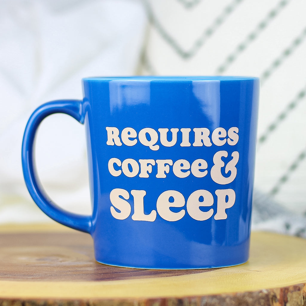 This 14oz ceramic coffee mug is perfect for morning coffee, afternoon tea, or whatever hot beverage you enjoy! Comes in a glossy blue color & yields a vivid screen printed graphic that retains its quality when dish-washed & microwaved. Dishwasher & microwave safe. Made in the USA. Ships worldwide. Funny coffee quote.