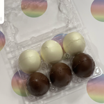 Egg shaped hot chocolate bombs in milk or white chocolate