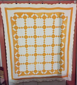 Crisp and clean two-coloured quilt - cheddar and white