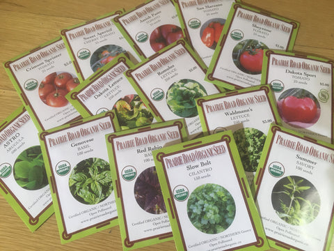 Organic seed packets offering your choice of varieties of tomato, lettuce, and herbs.