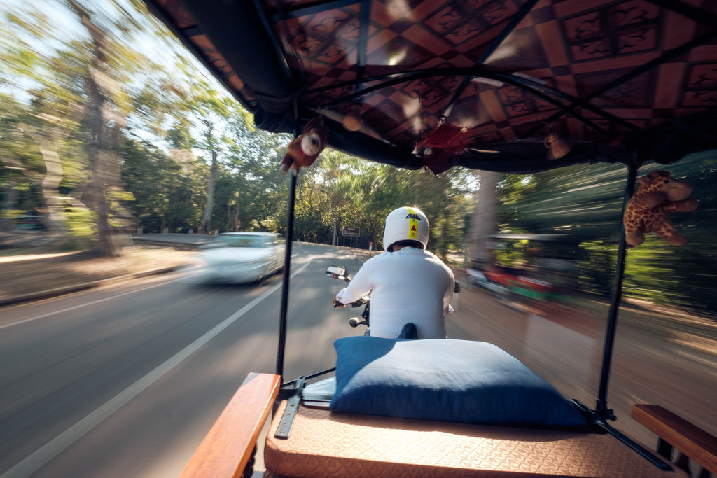 Traveling by Tuk Tuk in Cambodia by Christian Holzinger