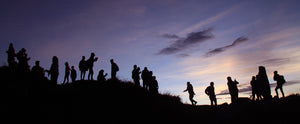 Students hiking together in the evening