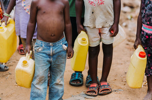 Children with containers to carry water
