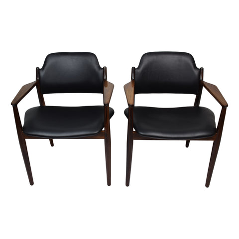A pair of rosewood armchairs by Arne Vodder, model 62A, produced by Sibast, aniline leather upholstery