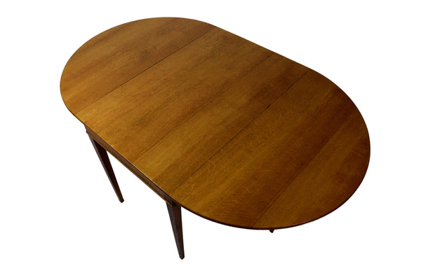 An early Danish mid century drop leaf table by Frits Henningsen, six legs, oak