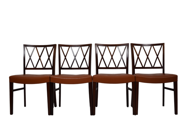A set of four rosewood dining chairs by Ole Wanscher, leather upholstery