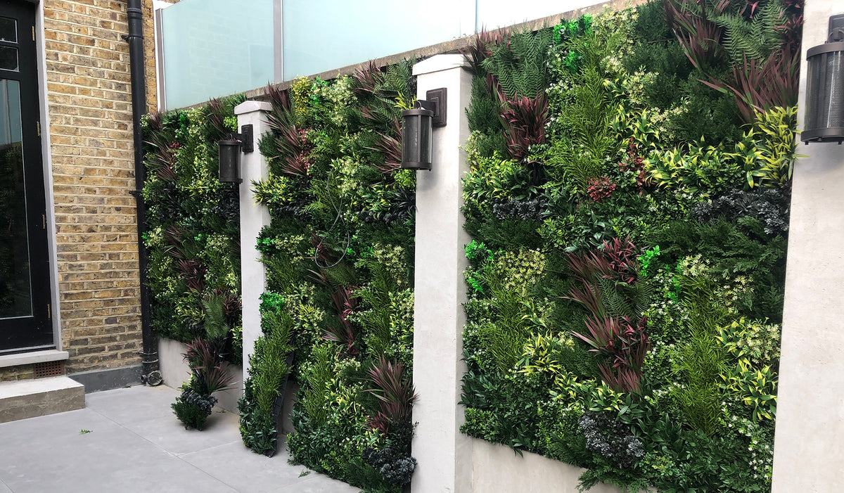 Artificial premium 3D plant wall with green, purple, red and white foliage fire retardant