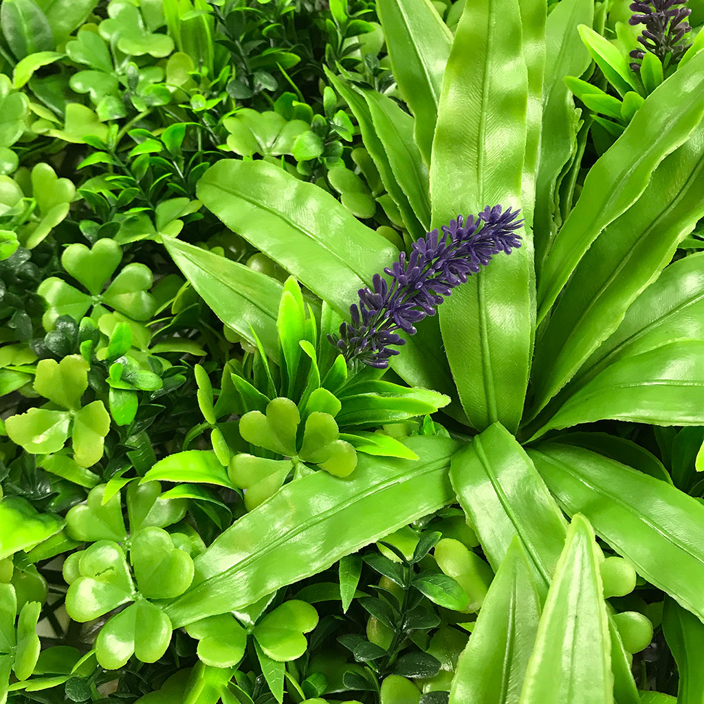 Artificial green wall panel with mixed foliage, palm heads and purple flowers 100x100 cm