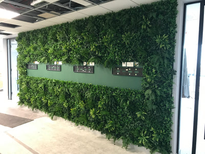 Artificial green wall panel with variegated foliage ivy palms grasses and ferns  100x100 cm