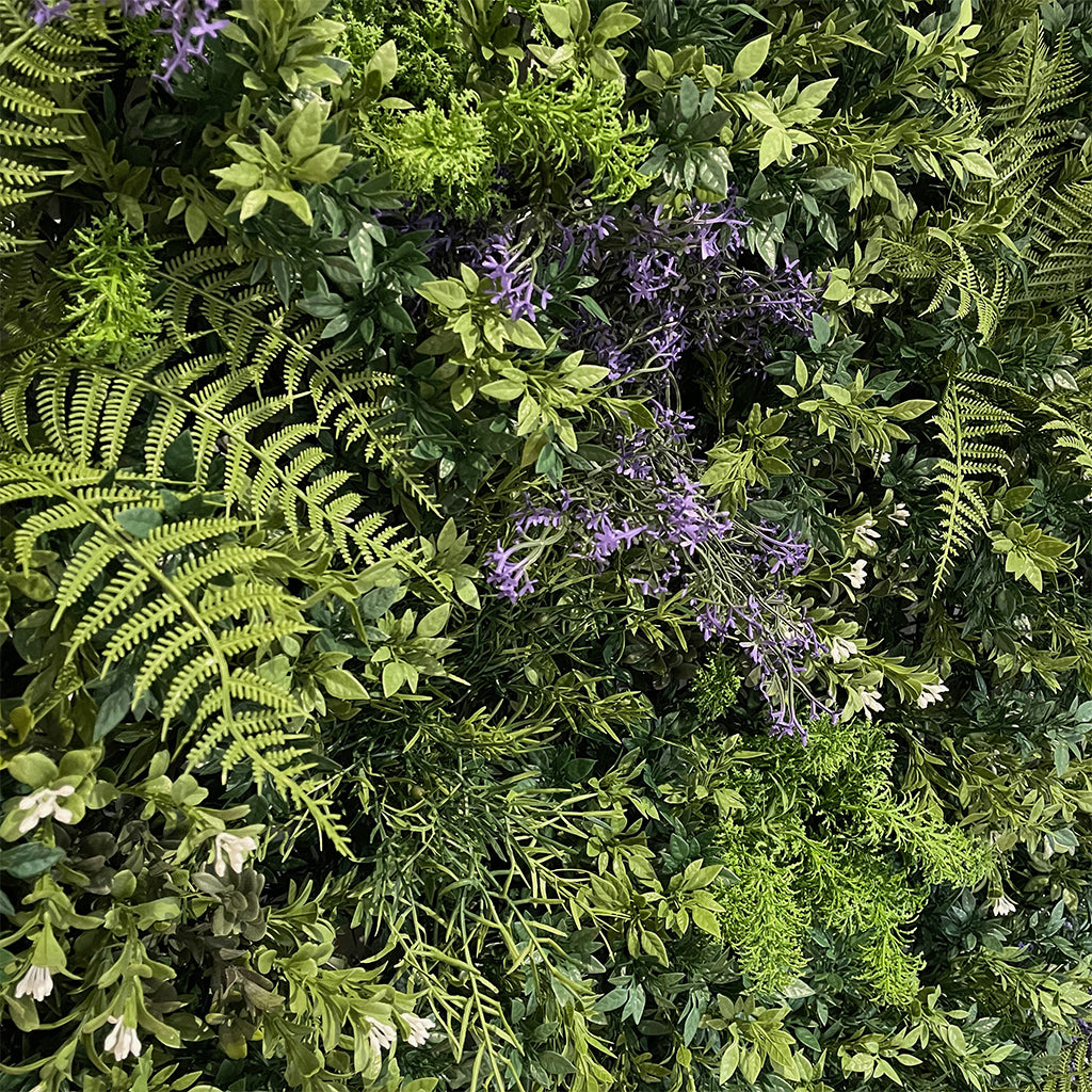 Artificial 3D plant wall with green foliage and small purple flowers - fire retardant - 100x100cm