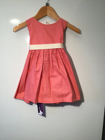 Coral with cream spots girl's dress