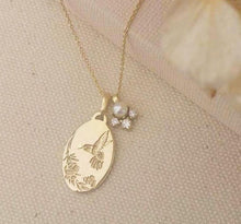 Hummingbird necklace, vintage style oval pendant with diamonds and pearl charm